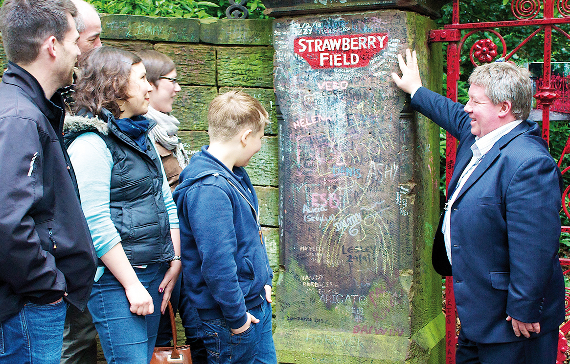 Blue Badge Guide Paul Beesley with a tour group at Strawberry Field