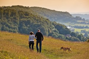 People and dog walking on Selsley Common, Stroud, Gloucestershire