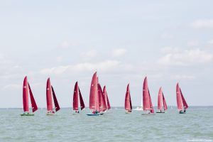 Sailing boats racing on the Solent during Cowes Week, the largest sailing regatta of its kind in the world.