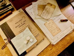 the three sugar cubes left in a Cabinet War Rooms Map Room drawer by an RAF officer - re-discovered (with a note from his wife) in the 70s