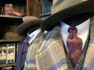 A suit and tie and hat in a shop in London
