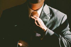 Man adjusting a tie