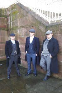 3 men dressed as 'Peaky Blinders'