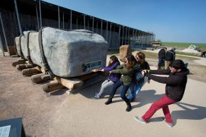 Children pulling a huge stone near Stonehenge