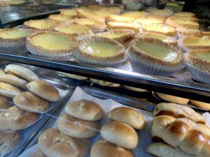 Close up of custard tarts and pork bun