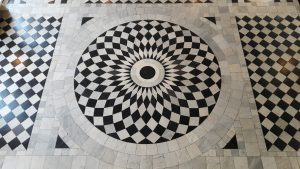 Black and white tiled floor in a circle