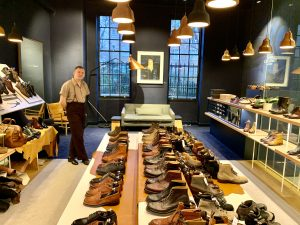 A shoe shop with shoes lined up