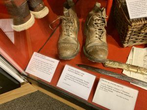 An old pair of boots on display in a museum