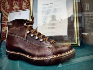 A single hiking boot in brown leather